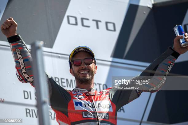 Andrea Dovizioso of Italy and Ducati Team celebrates the victory on the podium at the end of the MotoGP race during the MotoGP of San Marino Race at...
