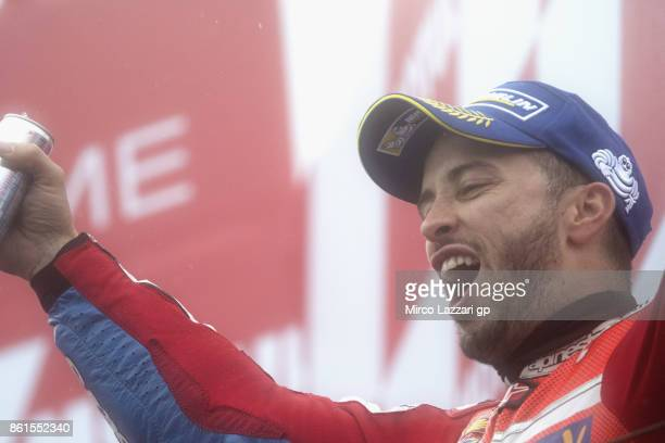 Andrea Dovizioso of Italy and Ducati Team celebrates the victory on the podium at the end of the MotoGP race during the MotoGP of Japan Race at Twin...