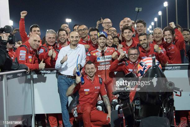 Andrea Dovizioso of Italy and Ducati Team celebrates the victory under the podium with team at the end of the MotoGP race during the MotoGP of Qatar...