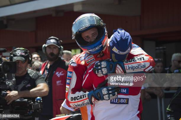 Andrea Dovizioso of Italy and Ducati Team celebrates the victory under the podium at the end of the MotoGP race during the MotoGp of Catalunya Race...