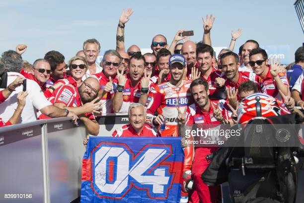 Andrea Dovizioso of Italy and Ducati Team celebrates the victory with team under the podium at the end of the MotoGP race during the MotoGp Of Great...