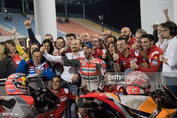 Andrea Dovizioso of Italy and Ducati Team celebrates the victory with team at the end of the MotoGP race during the MotoGP of Qatar Race at Losail...