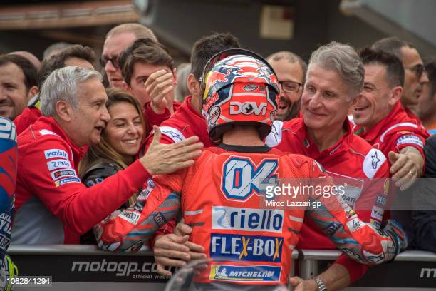 Andrea Dovizioso of Italy and Ducati Team celebrates with team at the end of the qualifying practice during the MotoGP Of Valencia - Qualifying at...