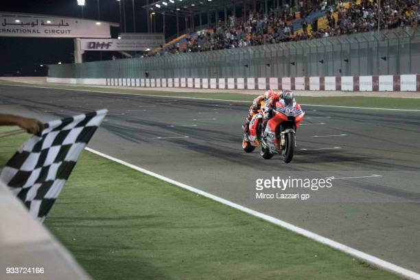 Andrea Dovizioso of Italy and Ducati Team cuts the finish lane in front of Marc Marquez of Spain and Repsol Honda Team and celebrates the victory at...