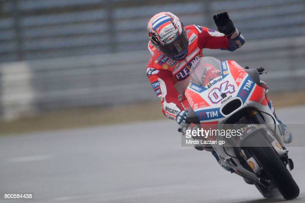 Andrea Dovizioso of Italy and Ducati Team greets the fans during the MotoGP Netherlands Qualifying on June 24 2017 in Assen Netherlands