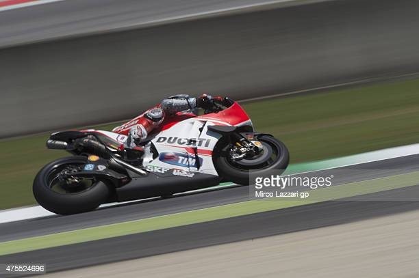 Andrea Dovizioso of Italy and Ducati Team heads rounds the bend during the Michelin tires test during the MotoGp Tests At Mugello at Mugello Circuit...