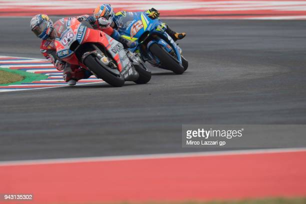 Andrea Dovizioso of Italy and Ducati Team leads Alex Rins of Spain and Team Suzuki ECSTAR during the qualifying practice during the MotoGp of...