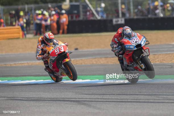 Andrea Dovizioso of Italy and Ducati Team leads Marc Marquez of Spain and Repsol Honda Team during the MotoGP race during the MotoGP Of Thailand Race...