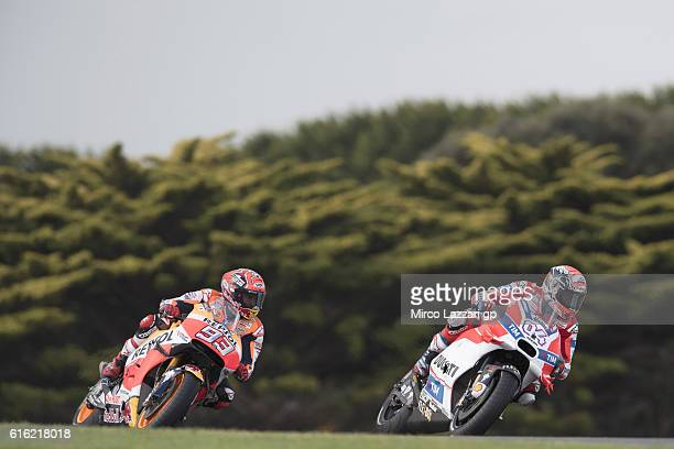 Andrea Dovizioso of Italy and Ducati Team leads Marc Marquez of Spain and Repsol Honda Team during the qualifying practice during qualifying for the...