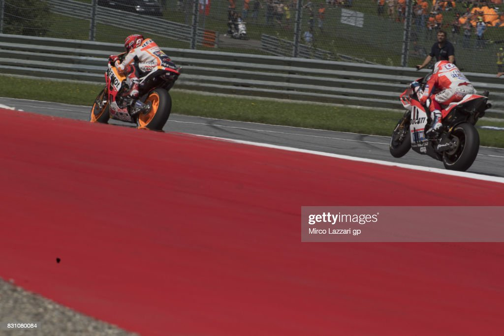 Andrea Dovizioso of Italy and Ducati Team leads Marc Marquez of Spain and Repsol Honda Team during the MotoGP race during the MotoGp of Austria - Race at Red Bull Ring on August 13, 2017 in Spielberg, Austria.
