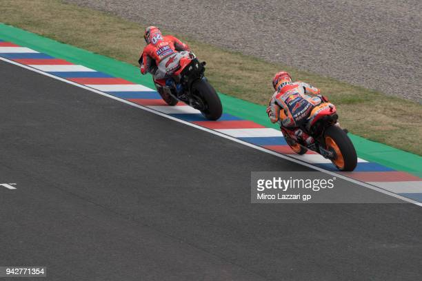 Andrea Dovizioso of Italy and Ducati Team leads Marc Marquez of Spain and Repsol Honda Team during the MotoGp of Argentina Free Practice on April 6...