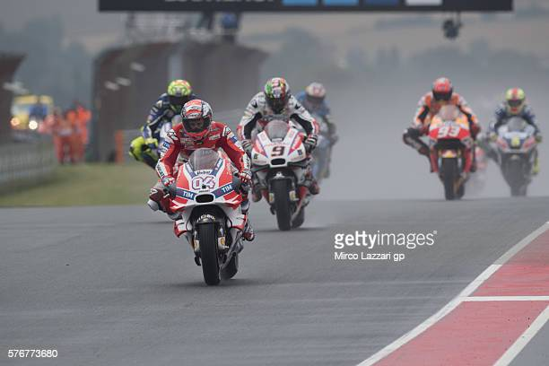 Andrea Dovizioso of Italy and Ducati Team leads the field during the MotoGP race during the MotoGp of Germany Race at Sachsenring Circuit on July 17...