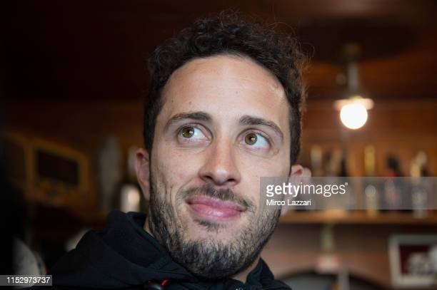 """Andrea Dovizioso of Italy and Ducati Team looks on in restaurant """"Passo della Futa"""" during the MotoGp of Italy - Filming Day at Mugello Circuit on..."""