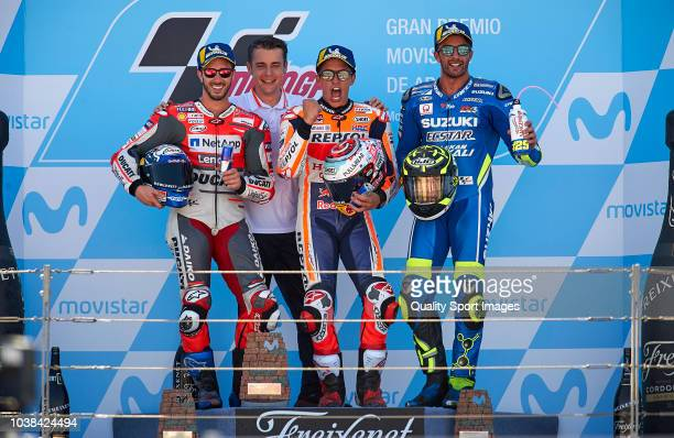 Andrea Dovizioso of Italy and Ducati Team Marc Marquez of Spain and Repsol Honda Team and Andrea Iannone of Italy and Team Suzuki Ecstar on the...