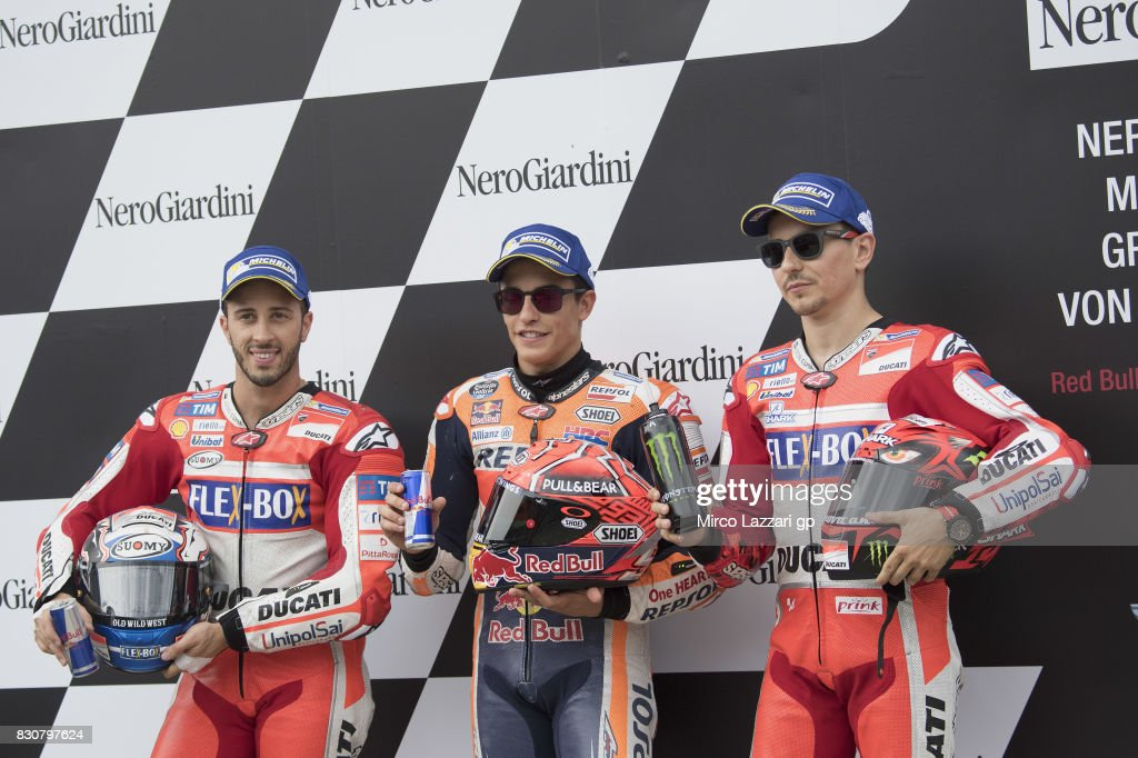 Andrea Dovizioso of Italy and Ducati Team, Marc Marquez of Spain and Repsol Honda Team and Jorge Lorenzo of Spain and Ducati Team celebrate at the end of the qualifying practice during the MotoGp of Austria - Qualifying at Red Bull Ring on August 12, 2017 in Spielberg, Austria.