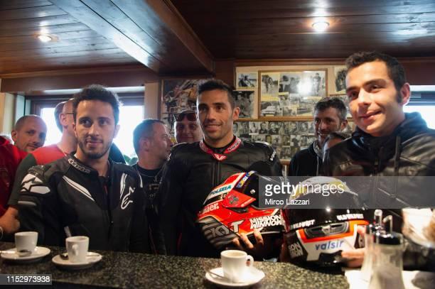 Andrea Dovizioso of Italy and Ducati Team Michele Pirro of Italy and Ducati Team and Danilo Petrucci of Italy and Ducati Team drink a coffee in...