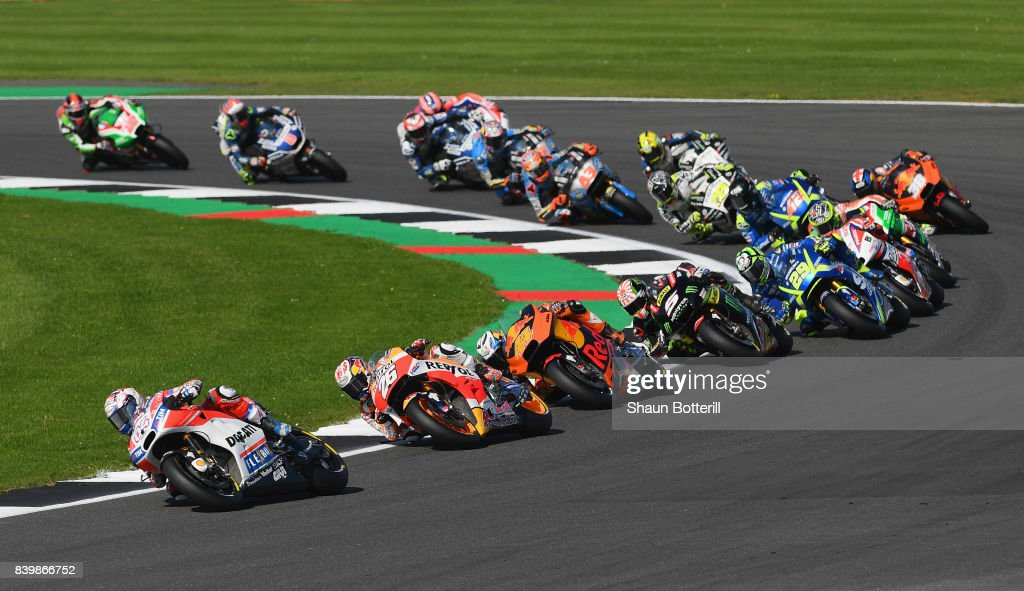 Andrea Dovizioso of Italy and Ducati Team on the first lap during the MotoGP of Great Britain at Silverstone Circuit on August 27, 2017 in Northampton, England.