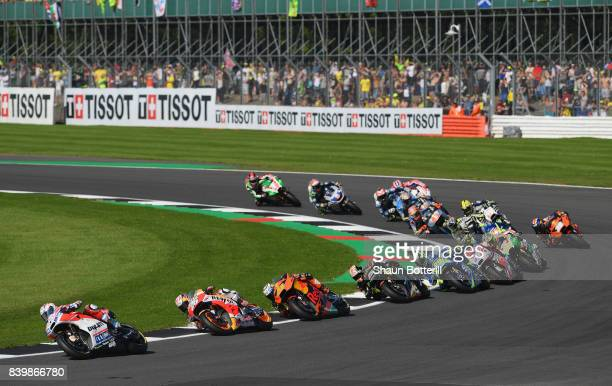 Andrea Dovizioso of Italy and Ducati Team on the first lap during the MotoGP of Great Britain at Silverstone Circuit on August 27 2017 in Northampton...