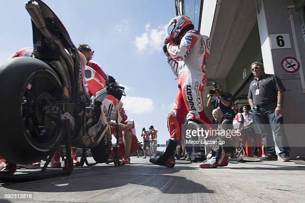Andrea Dovizioso of Italy and Ducati Team prepares to start in box during the qualifying practice during the MotoGp of Czech Republic Qualifying at...