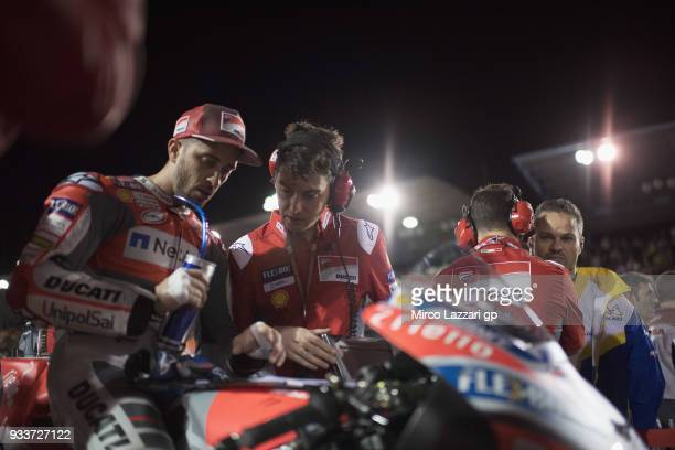 Andrea Dovizioso of Italy and Ducati Team prepares to start on the grid during the MotoGP race during the MotoGP of Qatar Race at Losail Circuit on...