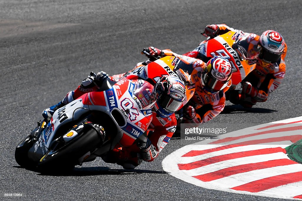Andrea Dovizioso of Italy and Ducati Team rides to win ahead Marc Marquez of Spain and Repsol Honda Team and Dani Pedrosa of Spain and Repsol Honda Team during the MotoGp of Catalunya at Circuit de Catalunya on June 11, 2017 in Montmelo, Spain.