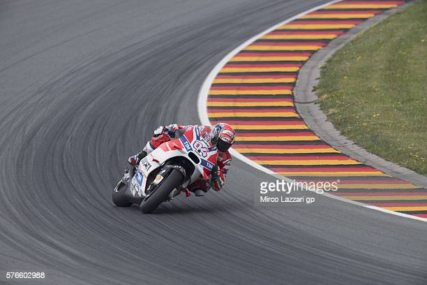Andrea Dovizioso of Italy and Ducati Team rounds the bend during the MotoGp of Germany Qualifying at Sachsenring Circuit on July 16 2016 in...