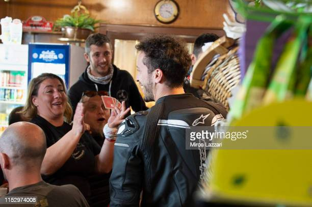 Andrea Dovizioso of Italy and Ducati Team smiles with Ducati fans in restaurant Passo della Futa during the MotoGp of Italy Filming Day at Mugello...