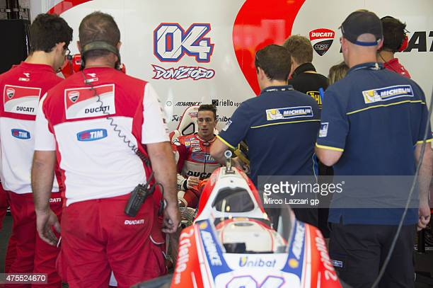 Andrea Dovizioso of Italy and Ducati Team speaks with mechanics during the Michelin tires test during the MotoGp Tests At Mugello at Mugello Circuit...