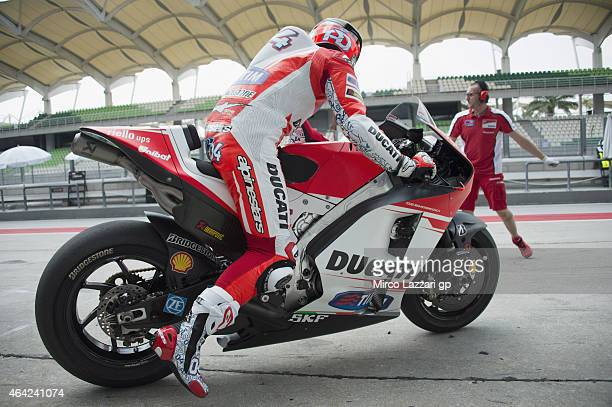 Andrea Dovizioso of Italy and Ducati Team starts from box with the new bike during the MotoGP Tests in Sepang Day One at Sepang Circuit on February...
