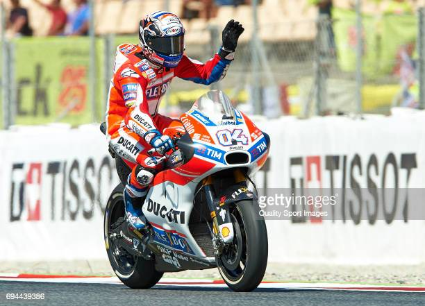 Andrea Dovizioso of Italy and Ducati Team waves to the crowd after free practice for the MotoGP of Catalunya at Circuit de Catalunya on June 10 2017...
