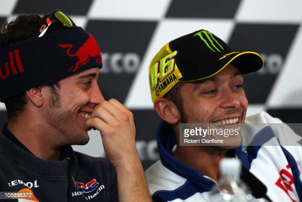 Andrea Dovizioso of Italy and the Repsol Honda Team laughs with Valentino Rossi of Italy and the Fiat Yamaha Team during a press conference prior to...