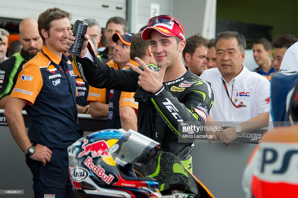 Andrea Dovizioso of Italy and Yamaha Tech 3 celebrates coming third place at the end of the MotoGP race of the MotoGp of Germany at Sachsenring Circuit on July 8, 2012 in Hohenstein-Ernstthal, Germany.