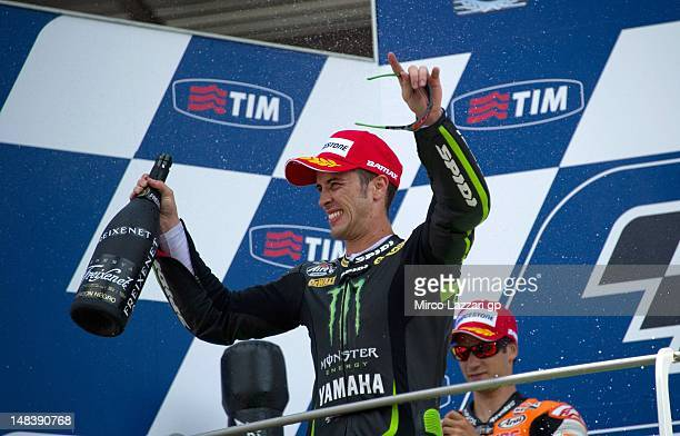 Andrea Dovizioso of Italy and Yamaha Tech 3 celebrates third place on the podium after the MotoGP of Italy at Mugello Circuit on July 15 2012 in...