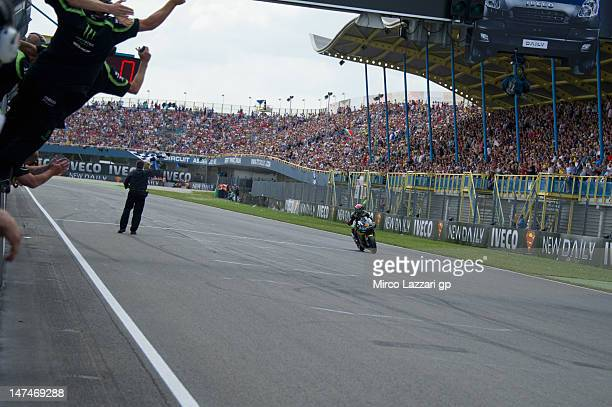 Andrea Dovizioso of Italy and Yamaha Tech 3 cuts the finish lane at the end of the MotoGP race of the MotoGp Of Holland at TT Circuit Assen on June...