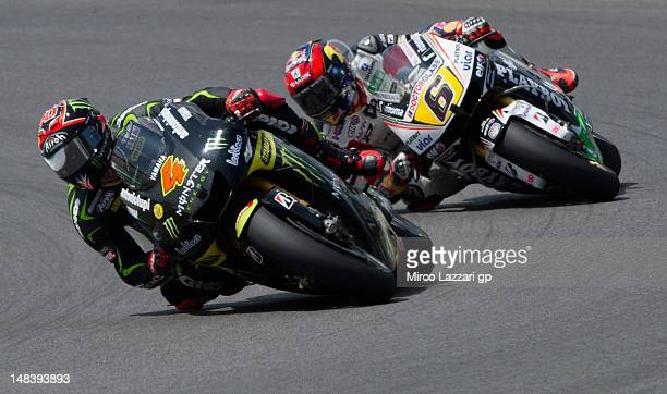 Andrea Dovizioso of Italy and Yamaha Tech 3 leads Stefan Bradl of Germany and LCR Honda MotoGP during the MotoGP race of the MotoGP of Italy at...