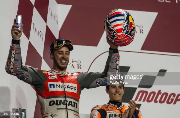 CIRCUIT LUSAIL DOHA QATAR Andrea Dovizioso on podium celebrate the first place Qatar Motorcycle Grand Prix race day at Losail International Circuit...