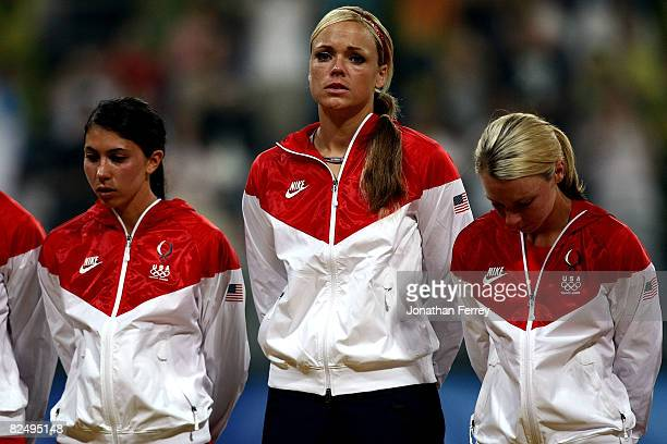 Andrea Duran Jennie Finch and Caitlin Lowe of the United States receive their silver medals after USA lost 31 to Japan during the women's grand final...