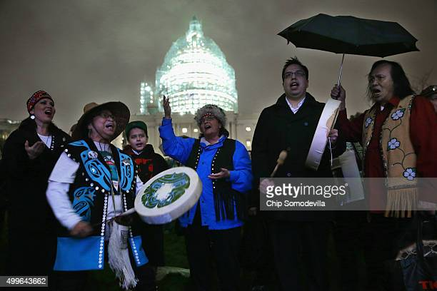 Andrea Ebona play drums and sing in honor of the Capitol Christmas tree on the West Front of the US Capitol December 2 2015 in Washington DC Ebona...