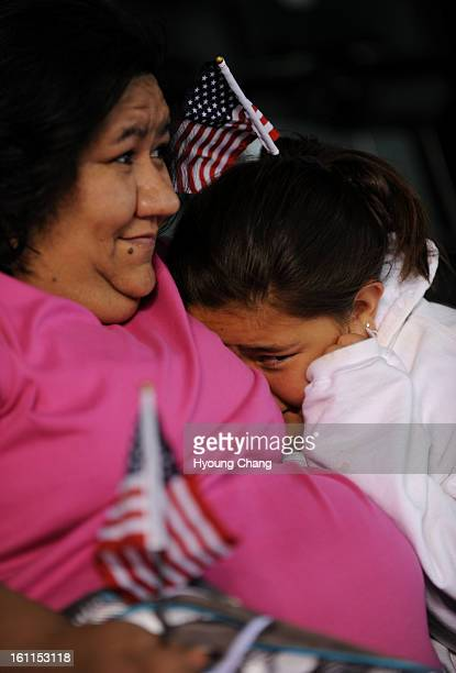 Andrea Escamilla of Denver right holds her mother Anjelina during the thunder Strom hits Coors Field before the Colorado Rockies game against Arizona...
