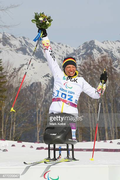Andrea Eskau of Germany celebrates winning gold at the flower ceremony after victory in the women's 6km Biathlon during day one of Sochi 2014...