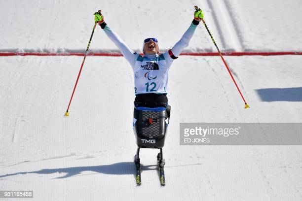 TOPSHOT Andrea Eskau of Germany crosses the finish line to win the women's 10km sitting biathlon event at the Alpensia Biathlon Centre during the...