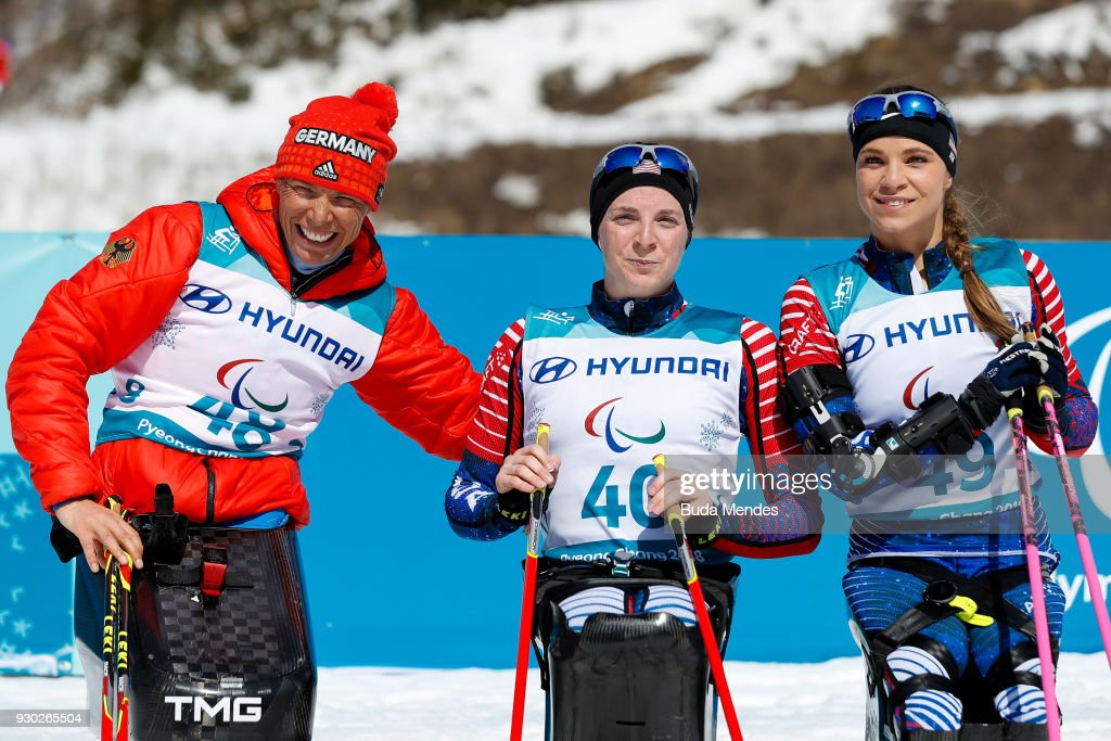 Andrea Eskau of Germany second place, Kendall Gretsch of the United States first place and Oksana Masters of the United States third place pose for photographers in the Women's Cross Country 12km - Sitting event at Alpensia Biathlon Centre during day two of the PyeongChang 2018 Paralympic Games on March 11, 2018 in Pyeongchang-gun, South Korea.