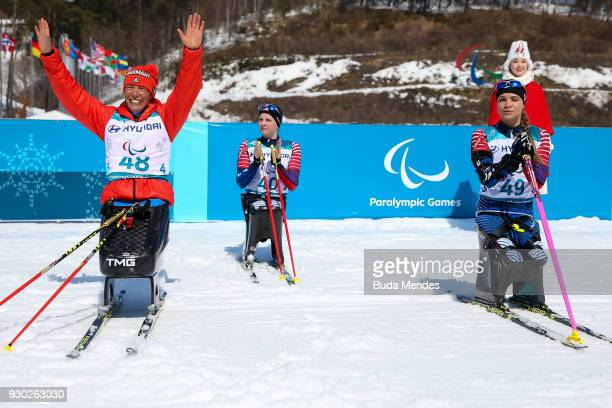Andrea Eskau of the Germany celebrates after crossing the finish line in second place in the Women's Cross Country 12km Sitting event at Alpensia...