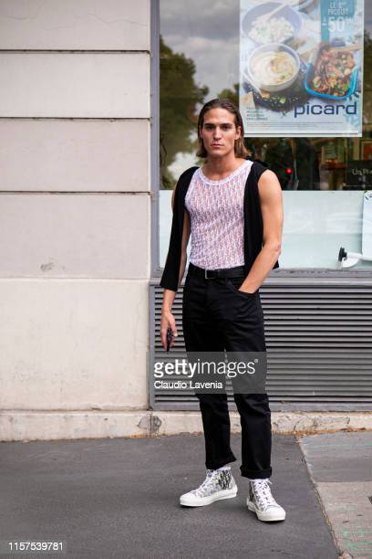 Andrea Faccio wearing a white Dior top black pants black sweater and Dior sneakers is seen outside Dior fashion show on Day 4 during the Paris...