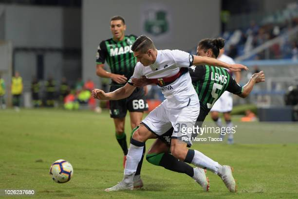 Andrea Favilli of Genoa CFC competes for the ball with Mauricio Lemos of US Sassuolo during the serie A match between US Sassuolo and Genoa CFC at...