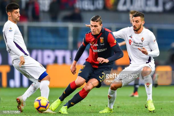 Andrea Favilli of Genoa Marco Benassi and Federico Ceccherini of Fiorentina of Fiorentina vie for the ball during the Serie A match between Genoa CFC...