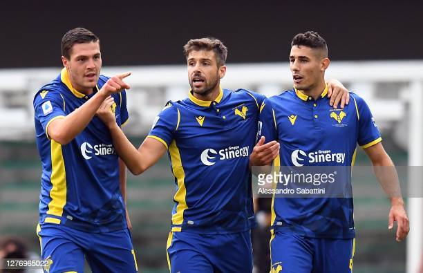 Andrea Favilli of Hellas Verona celebrates after scoring the opening goal with team mates during the Serie A match between Hellas Verona FC and...