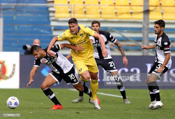 Andrea Favilli of Hellas Verona FC competes for the ball with Vincent Laurini of Parma Calcio during the Serie A match between Parma Calcio and...