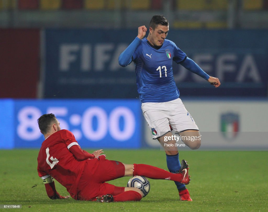 Andrea Favilli of Italy U21competes for the ball with Nikita Chernov of Russia U21 during the international friendly match between Italy U21 and Russia U21 on November 14, 2017 in Frosinone, Italy.