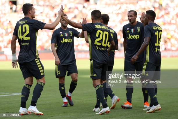 Andrea Favilli of Juventus and Joao Cancelo of Juventus celebrates with teammates after an own goal scored by Dani Carvajal of Real Madrid during the...